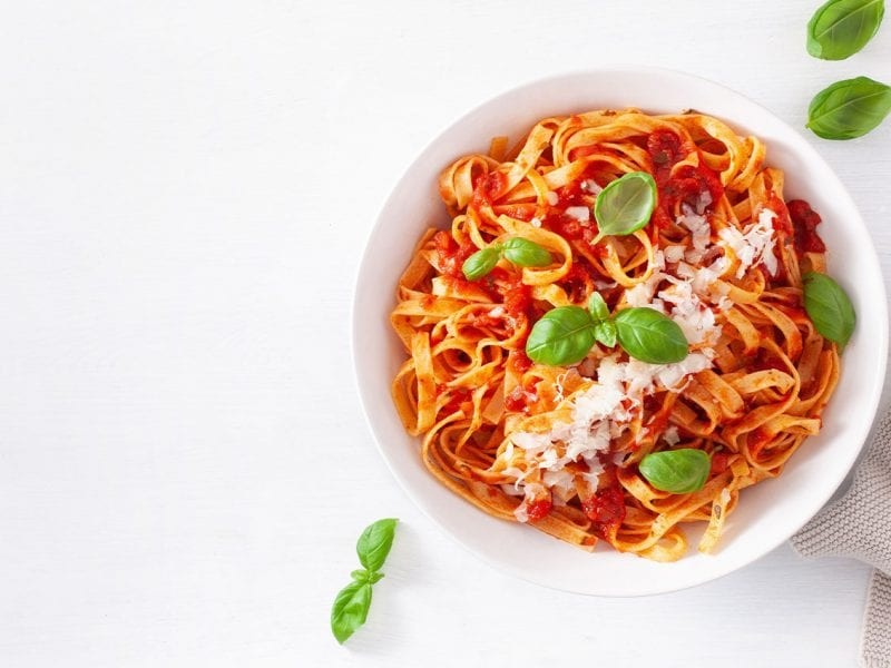 A big bowl of Arrezzio Italian pasta with tomato sauce and basil.