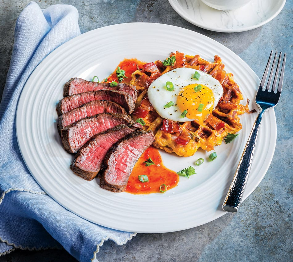 Steak and Egg-Topped Sweet Potato Hash Waffle Over Bourbon-Chile Glaze
