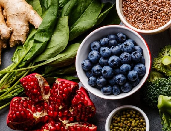food ingredients including ginger, spinach, pomegranate, blueberries, broccoli, and grains - Sysco Simply