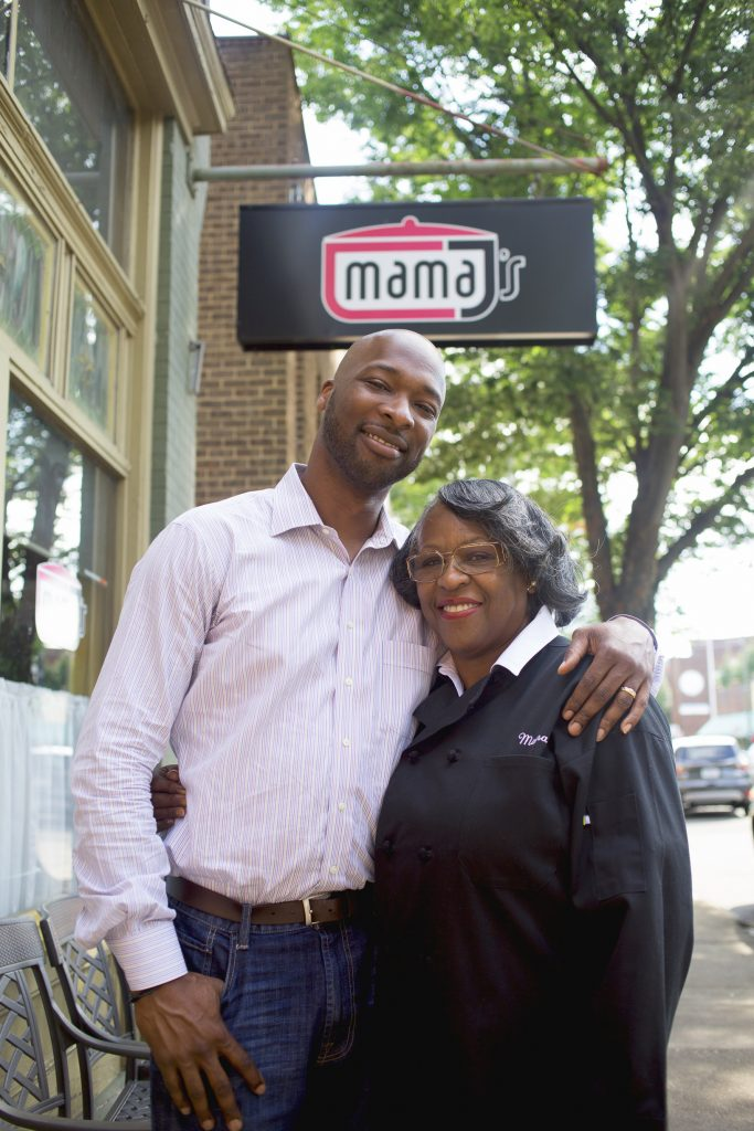 Mama and Lester Johnson in front of Mama J's restaurant