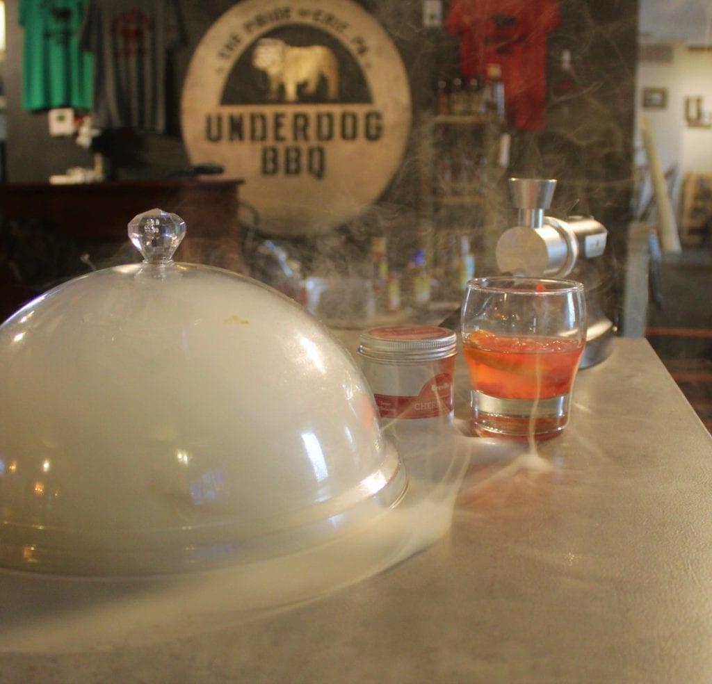 Cowboy smoke in a cloche at Underdog BBQ