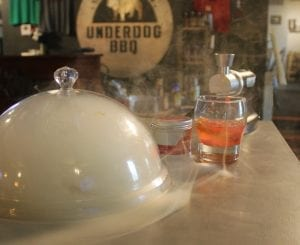 Cowboy smoke in a cloche at Underdog BBQ