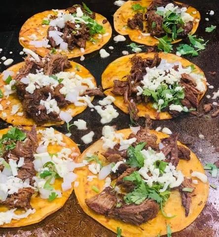 Barbacoa tacos preparation - Melecios Authentic Mexican Restaurant